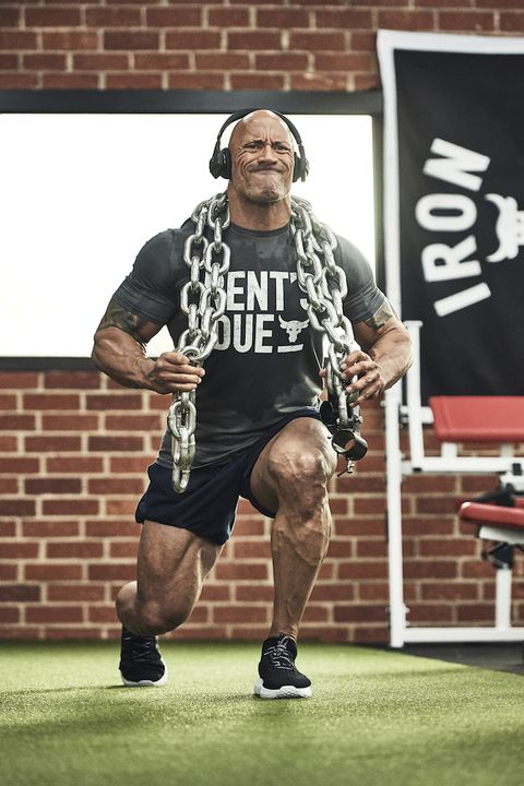 Dwayne 'The Rock' Johnson doing lunges with chains for weight